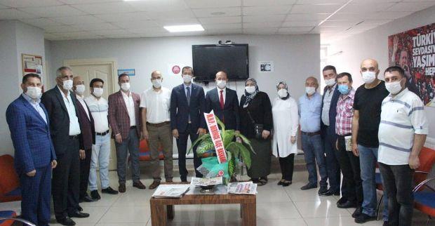 MHP'den AK Parti'ye hayırlı olsun ziyareti