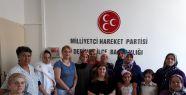 MHP DERİNCE KADIN KOLLARI 15 TEMMUZ ŞEHİTLERİNİ...